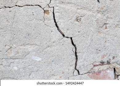 Massive crack in the wall concrete in extreme closeup. Concept blueprint for destruction, lose or broken soemetheing.