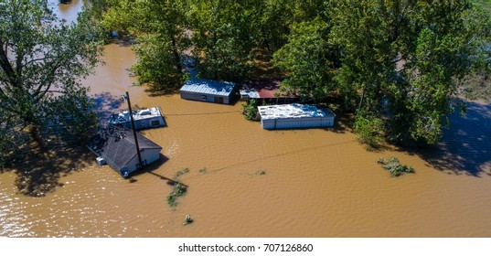 Massive Flooding Home under water from Hurricane Harvey in La Grange , Texas Flooding and destruction after Hurricane Harvey flooded neighborhood a group of houses with water up to the roof