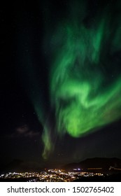 Massive green Northern lights shining over Nuuk city, Greenland