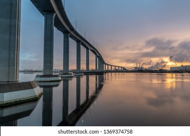 The massive Jordan Bridge over the Elizabeth River in Virginia, reflecting in the water at sunset, in high resolution