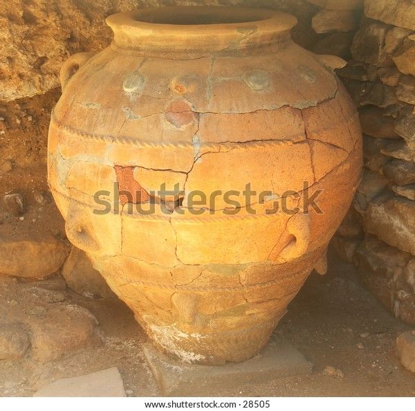 Massive Minoan storage jar, restored and on display at Phaistos archaeological site, Crete. It is almost 2 meters high. From about 3,300 years ago.