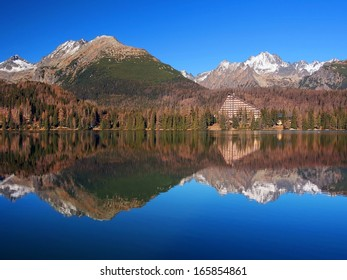 Massive peaks of High Tatras reflected in Strbske Pleso (tarn). Strbske Pleso is second largest glacial lake on the Slovak side of High Tatras. This tarn is located in Tatras National Park (TANAP).