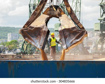 Massive scoop, part of a port crane, is navigated from worker while loading ship with wheat at Varna port, Varna, Bulgaria, May 16, 2015.