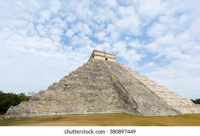 A massive step pyramid known as El Castillo at Chichen, Mexico