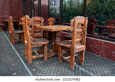 massive tables and chairs on the veranda of a street cafe