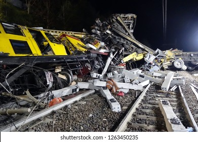 Massive train derail. Dramatic night scene of a head-on collision between two trains.