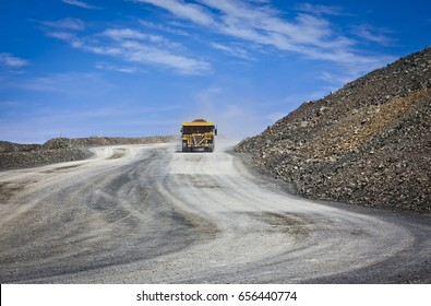 Massive trucks used to transport mining ore. Open-cast mine in Australia.