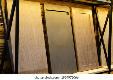 Massive wooden furniture facades in the store