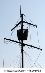 Mast of ancient pirate ship on the blue sky background