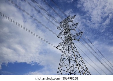 Mast electrical power line against cloud and blue sky
