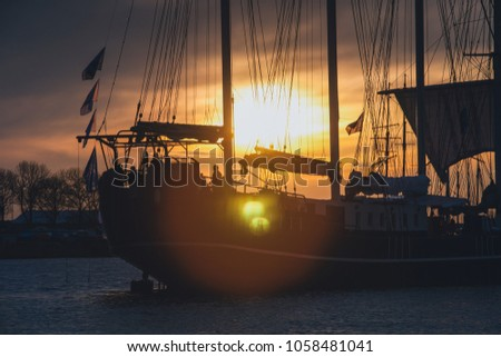 Mast of a sailboat in the rays of the setting sun