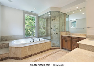 Master bath in luxury home with step up tub