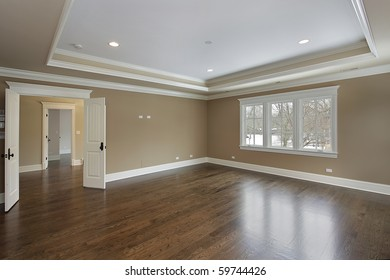 Master bath in new construction home with tray ceiling