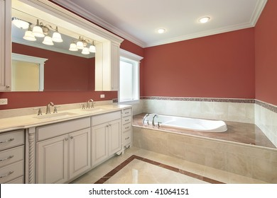 Master bath with salmon-colored walls