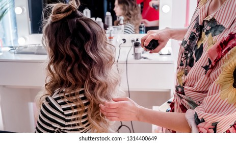 master in the beauty salon does hair