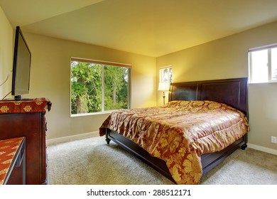 Master bedroom with carpet, windows, and king sized bed.
