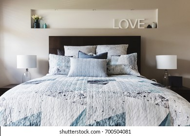 Master bedroom with contemporary quilt duvet and pillows