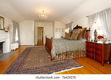 Master bedroom with fireplace and beautiful antique furniture. Luxury old home in Tacoma, WA.