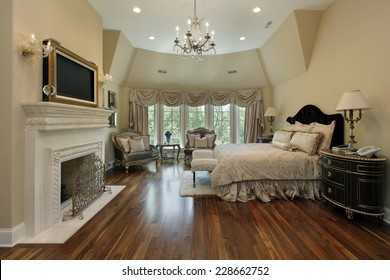 Master bedroom in luxury home with fireplace