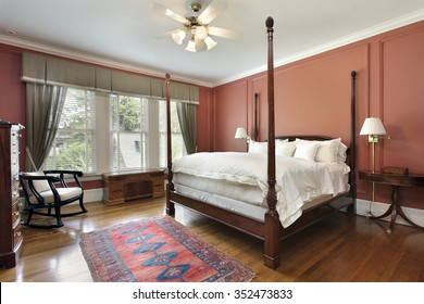 Master bedroom in luxury home with salmon colored walls