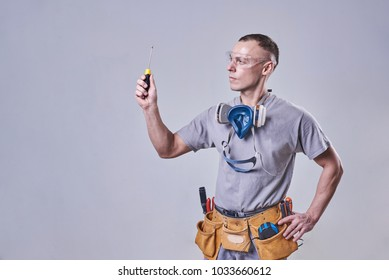 Master Builder-finisher in work clothes, holding a branch
