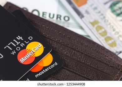 Master Card in the leather brown wallet, close up of credit cards. MasterCard Worldwide is an American multinational financial services corporation. Moscow, Russia - December 8, 2018