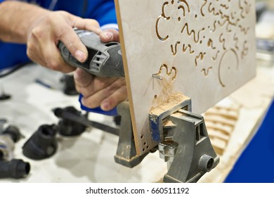 Master carpenter at work saws from plywood