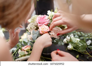 Master class on making bouquets for kids. Spring bouquet in metal ornamental flowerpot. Learning flower arranging, making beautiful bouquets with your own hands