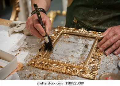 Master craftsman during the gilding process tecnique.
