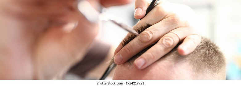 Master cuts man in beauty salon. Hairdresser profession training concept
