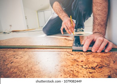 Master is engaged in the installation of cork flooring