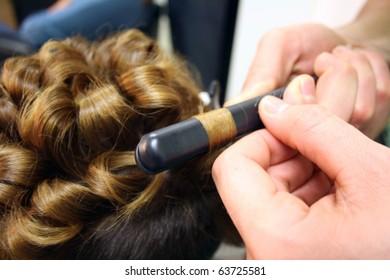 Master hairdresser cuts a customer's hair