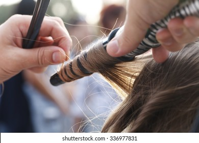 master hairdresser and stylist in the workflow closeup
