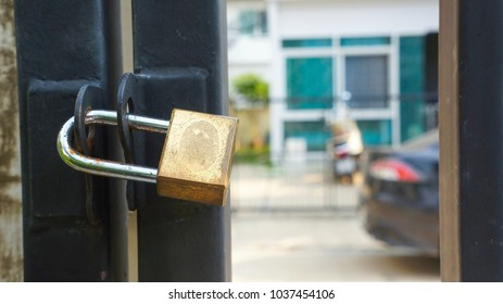 master key lock on gate and door of fence.