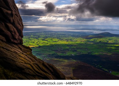 The Master of the Land: keeper of the place for ages, here are the lands and seas as Slieve Binian has always been seeing them, Mourne Mountains, County Down, Northern Ireland, United Kingdom