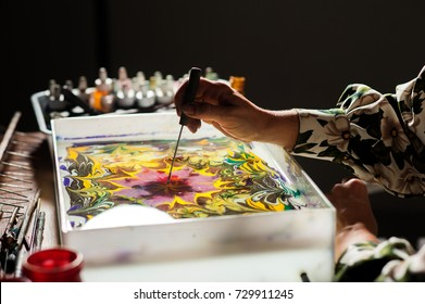 Master performs drawing with ebru technique