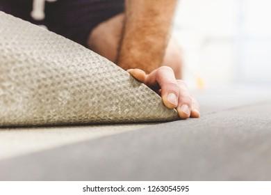 The master places commercial carpet - durable wear-resistant flooring