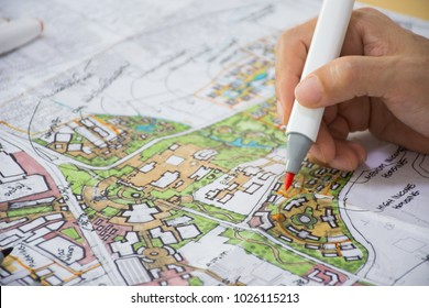 master plan of urban landscape design or urban architecture drawing by man's hand with color marker pen on white paper, with English and Thai language in plan drawing