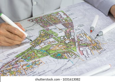 master plan of urban landscape design or urban architecture drawing by man's hand with color marker pen on white paper and group of color marker pens, with English and Thai language in plan drawing