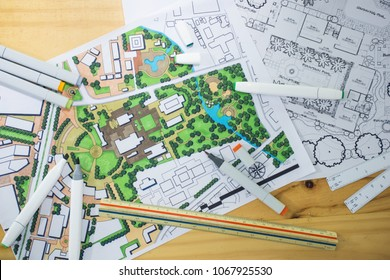 master plan of urban landscape design or urban architecture drawing with drawing tools , color markers, scale rulers on the table, selective focus
