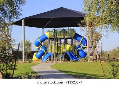 Master planned community park with covered play structure