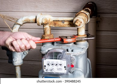 MAster plumber works on a gas meeter