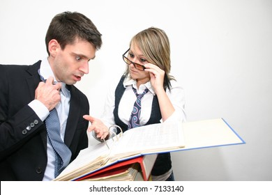master and servant - business woman is giving her colleague new tasks he seems to be unable to accomplish