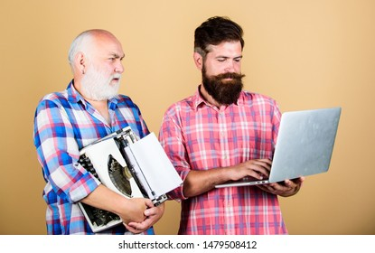 master service. youth vs old age. business approach. father and son. family generation. retro typewriter vs laptop. New technology. technology battle. Modern life. two bearded men. Vintage typewriter.