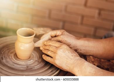 Master skulpturing a clay pot, potter hands, crafting concept