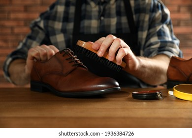 Master taking care of shoes in his workshop, closeup