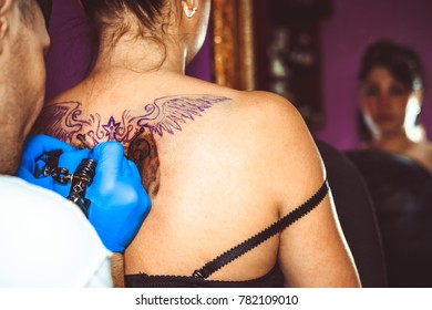 master tattoo woman on her back