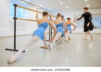 Master and young ballerinas rehearsing in class