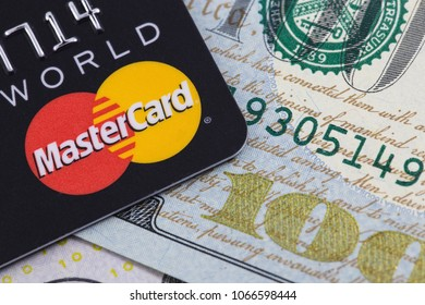 MasterCard and money, dollars. Ekaterinburg, Russia - April 11, 2018