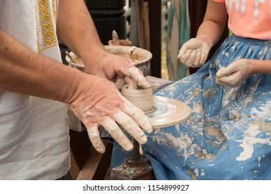 masterclass of clay pot production on potter's wheel